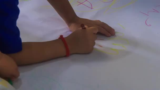 little kids drawing with pencils