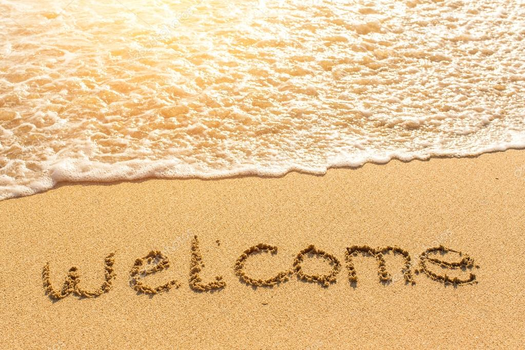 Welcome - drawn on beach sand