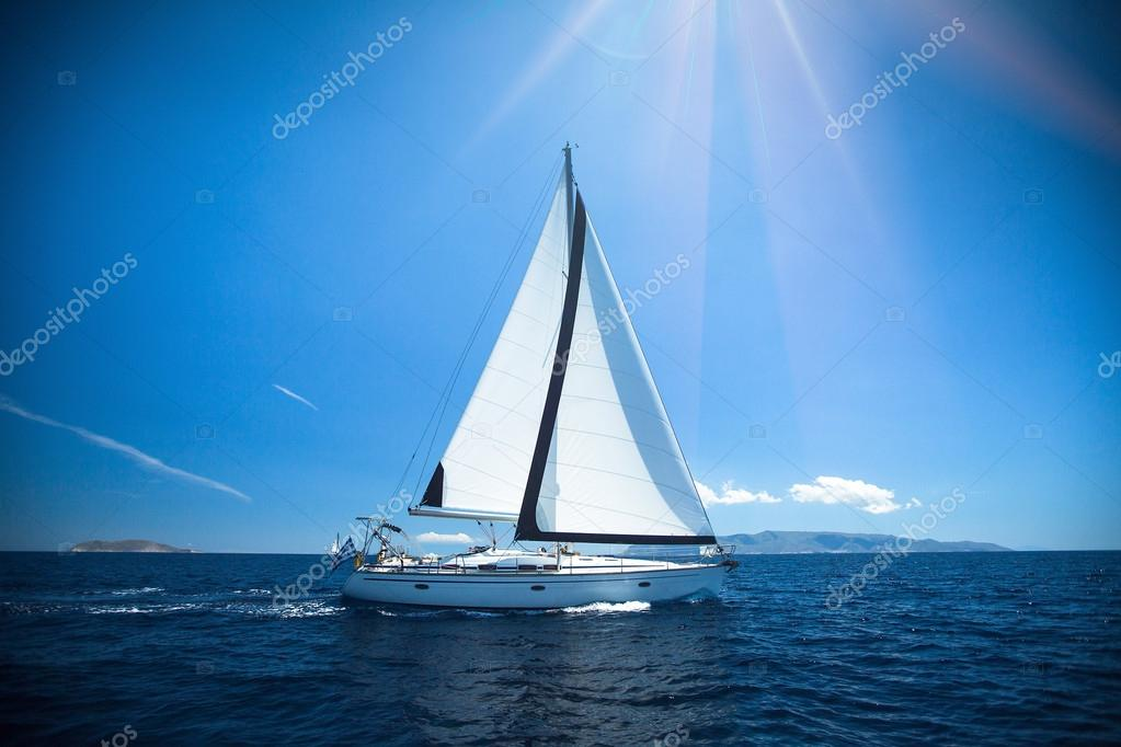 Ship yacht with white sails