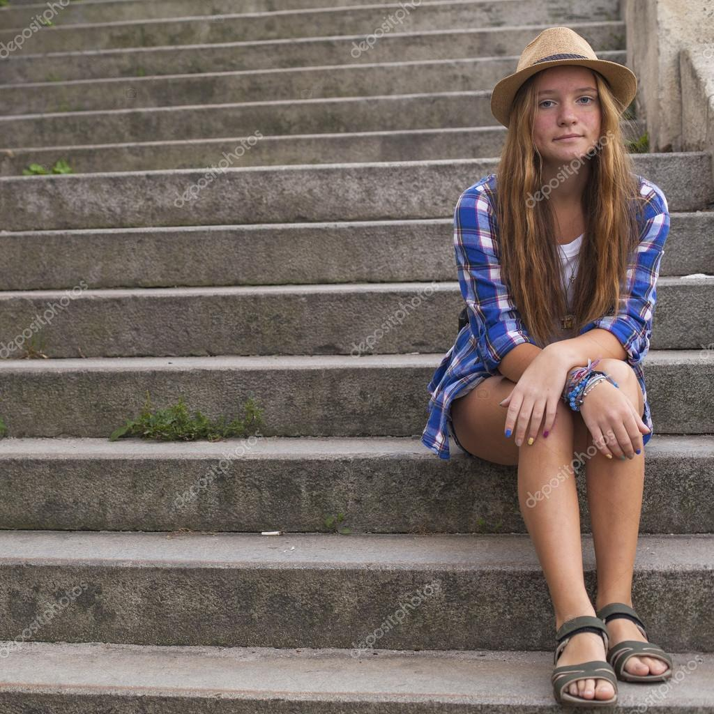 nude girl sitting steps