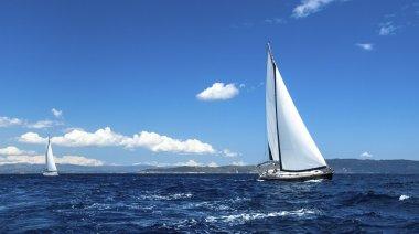 Sailing on a calm sea.