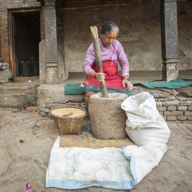 Woman working in the her pottery workshop