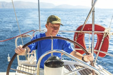 Young man skipper on  yacht.
