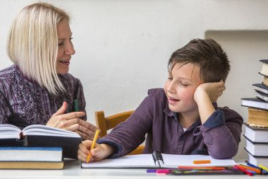Student does homework with his tutor
