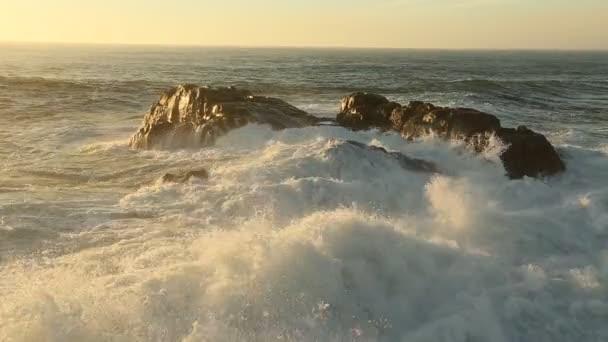 Surf on coastal rocks