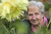 Fotografie mature woman in her garden