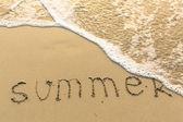 Fényképek Nyáron a homok írt
