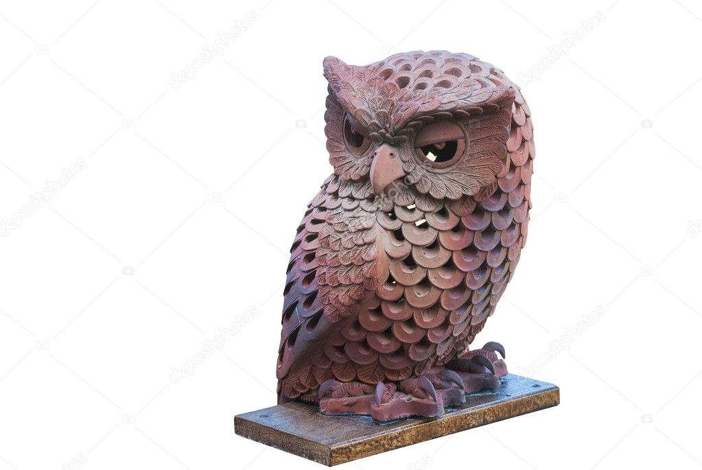 Owl made by brown clay on white blackground.