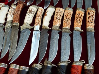 Knives with decorative handles. Background. Texture. Close-up. September, 2014.