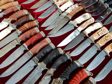 Background. Close-up. Texture. Knives with decorative handles. September, 2014.