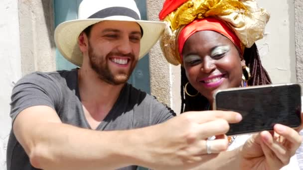 Tourist taking a selfie withBrazilian woman