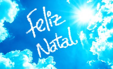 Happy Christmas (Portuguese: Feliz Natal) written on a beautiful sky