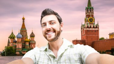 Happy young man taking a selfie photo in Moscow, Russia