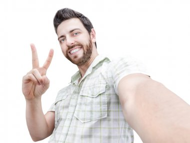 Happy young man taking a selfie photo isolated on white background
