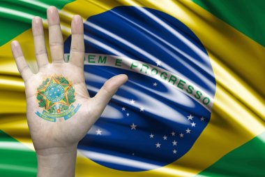 Hand and the Brazilian flag