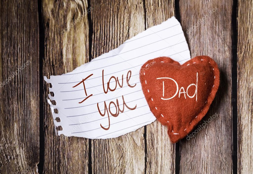 I Love You Dad Written On A Peace Of Paper And Heart Wooden Background Photo By Filipefrazao Find Similar Images