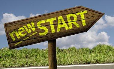 New Start wooden sign