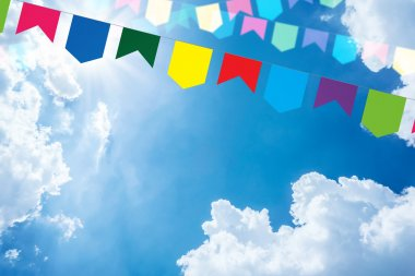 Colored bunting on a beautiful sky