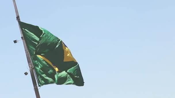 Brazilian waving flag on blue sky