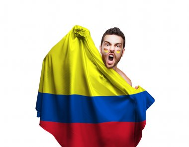 Fan holding the flag of Colombia on white background