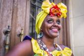 Fotografie Portrait of african cuban woman looking at camera smiling