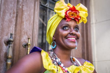 Portrait of african cuban woman looking at camera smiling