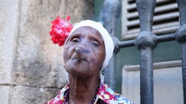 Cuban woman smoking cigar in Havana, Cuba