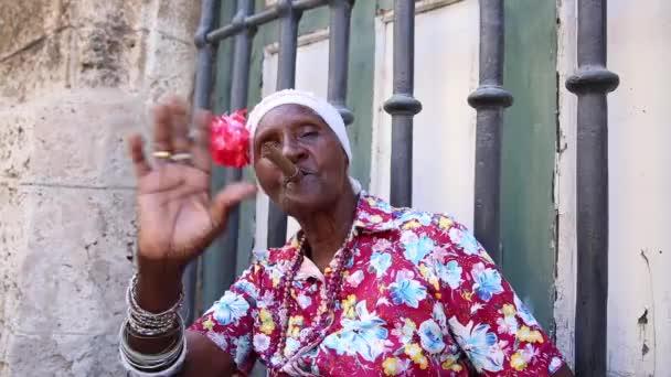 Cute cuban smoking cigar in Havana, Cuba