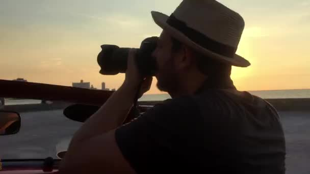 Photographer enjoying a nice view at Malecon in Havana, Cuba