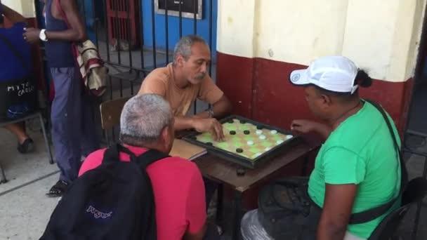 Cubans playing Domino on the street in Havana, Cuba