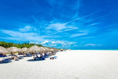 Thatched umbrellas at the famous Varadero beach in Cuba on a beautiful summer day