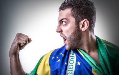 Man holding the Brazilian flag