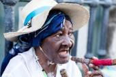 Fotografie Portrait of african cuban woman smoking cigar in Havana, Cuba
