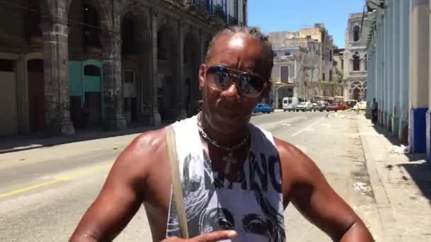 Cuban posing for photos in Havana, Cuba
