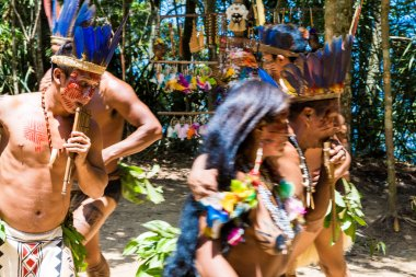 Native Brazilian man dancing at an indigenous tribe in the Amazon