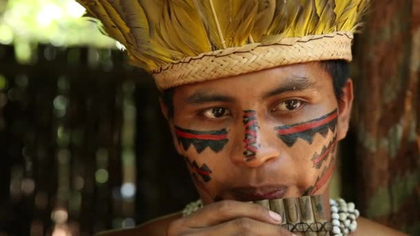 Native Brazilian playing wooden flute