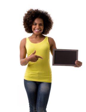 Brazilian woman holding a empty blackboard on white background