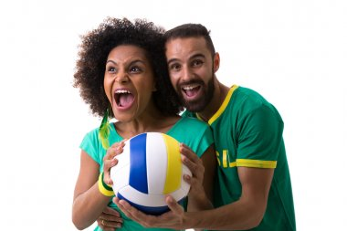 couple holding volleyball