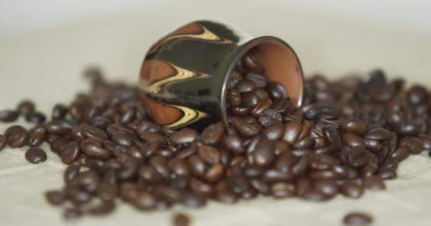 Brown coffee beans, close-up of coffee beans for background and textures