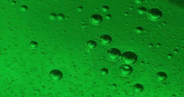 Bolle in gelatina di colore crema (gel di sapone). Extrime macro 4K
