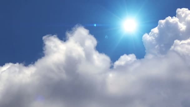Great white clouds with sun over the clean deep blue sky.