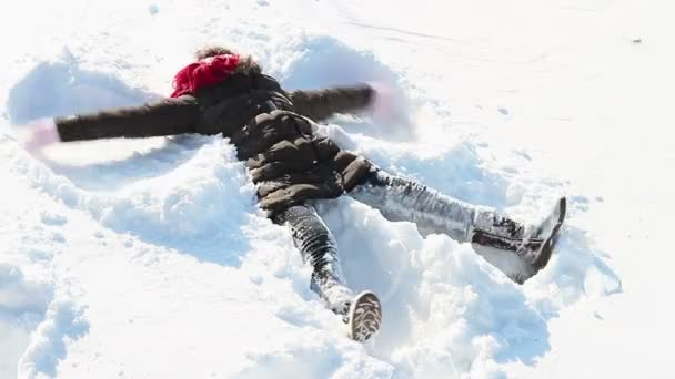 Little girl making snowangel