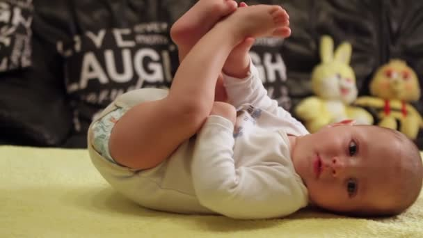 Adorable baby boy lying and smiling