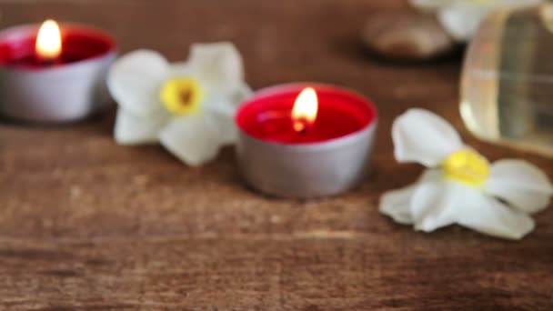 Spa csendélet sziklák, fürdősó, masszázs olaj és virágok