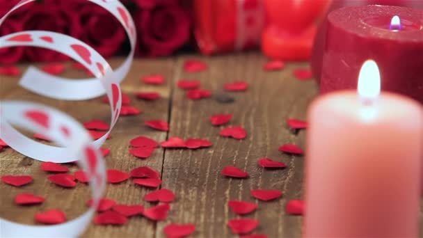 Red roses and gift box on wooden background
