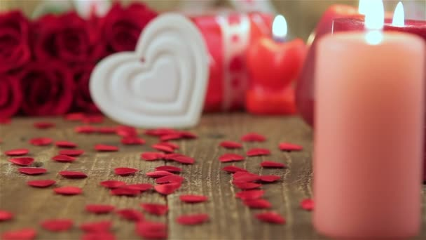 Red roses and heart shape on wooden background