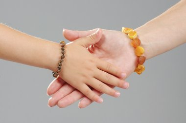 Family concept mother and daughter hands together