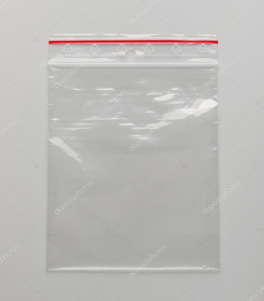 Self sealed packing bag on the grey background