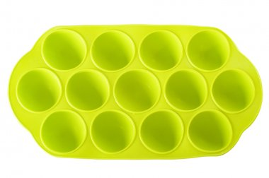 Green silicone ice cube tray isolated on the white background