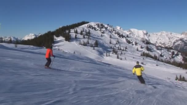 two skiers skiing o